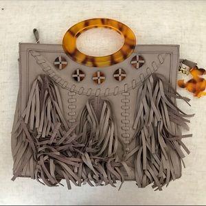 Grey leather satchel with tortoiseshell handle.